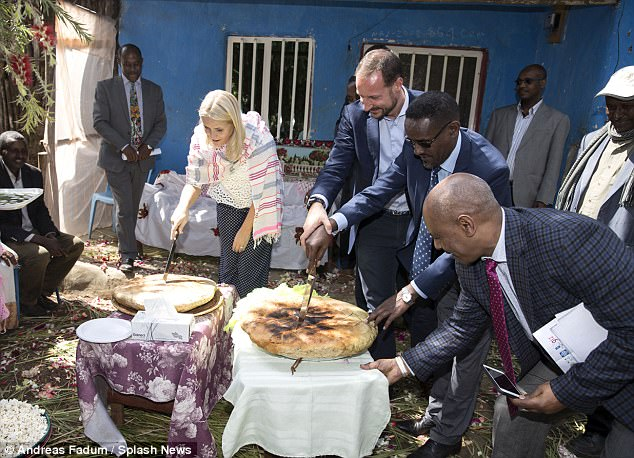 The royal couple sampled local delicacies during the trip and were spotted cutting into bread