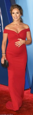 Bump in the night! Pregnant Jessie James Decker caressed her bump as she hit the red carpet