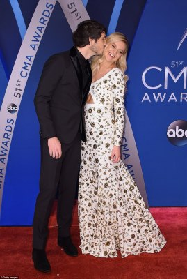 Hugs and kisses! Kelsea Ballerini was the picture of bliss as she got a kiss from her fiance, Morgan Evans