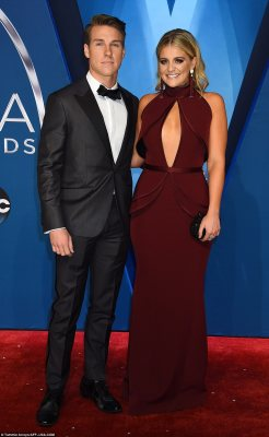 Picture perfect! Lauren Alaina wowed in her deep red and revealing floor length gown