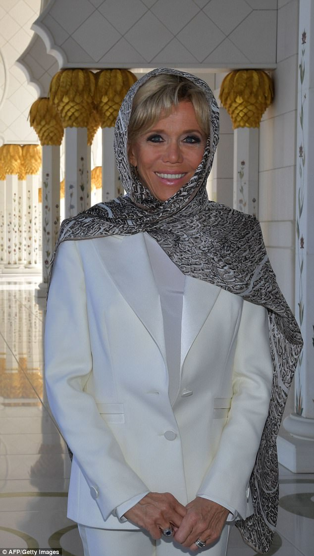 Mrs Macron covered her head with a grey and white silk scarf as a mark of respect