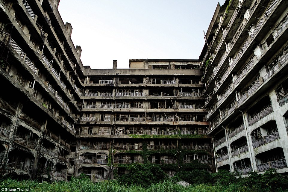 An apartment block on Hashima Island: Called 'Block 65', this was the largest housing complex on the island at nine storeys high with 317 apartments and a small playground on its rooftop. Hashima Island was abandoned in 1974 after its underground coal resources dried up