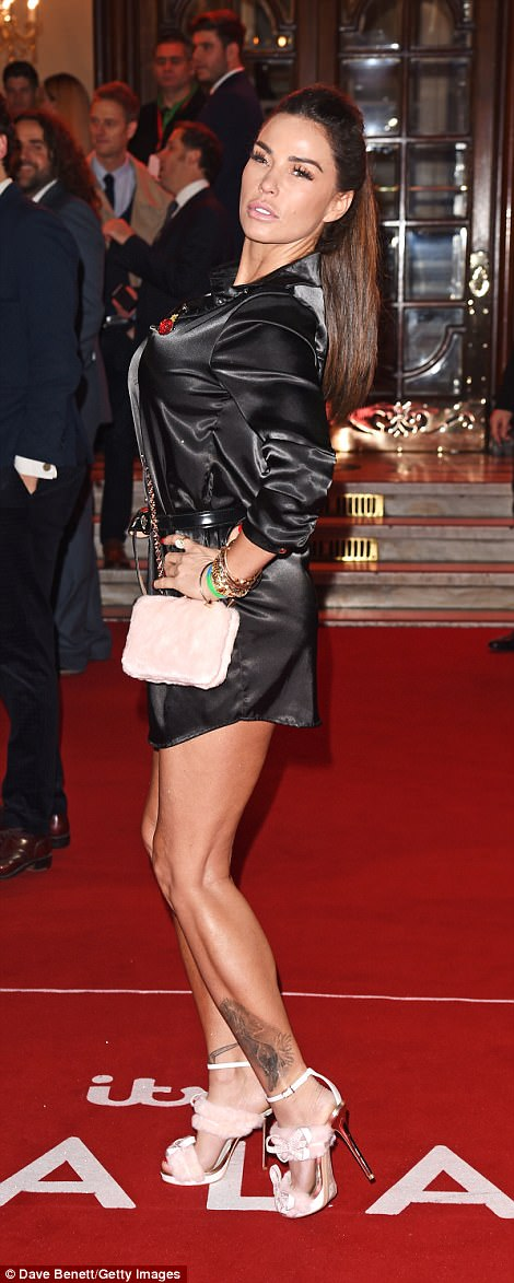 The Price is right! Katie Price took centre-stage in a slinky black shirt-dress, injecting a quirk edge to her look thanks to some pale pink fur-trim heels