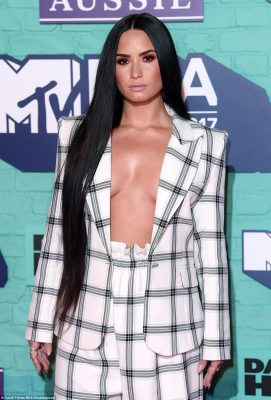 She's got front! Demi was keen on amping up the sexiness in her saucy ensemble, which saw her go braless under the unbuttoned blazer