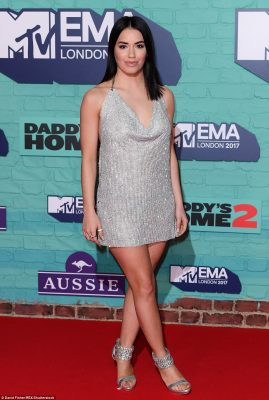 All eyes on her: Lali caught the eyes in a sparkling silver mini-dress and matching heels