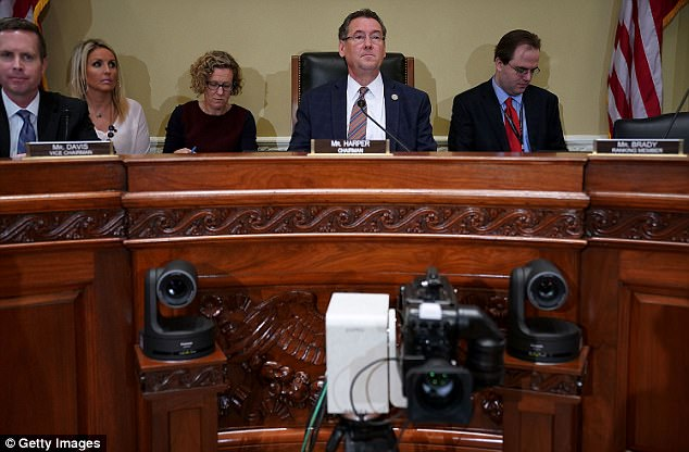 House Administration Committee Chairman Gregg Harper (R-MS) (C) prepares for a hearing in the Longworth House Office Building on Capitol Hill November 14, 2017 in Washington, DC
