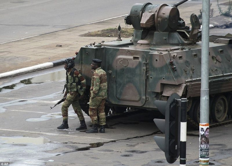 Image result for Zimbabwean soldiers man strategic positions in the capital city of Harare after the Army placed President Robert Mugabe under house arrest... on Monday. \