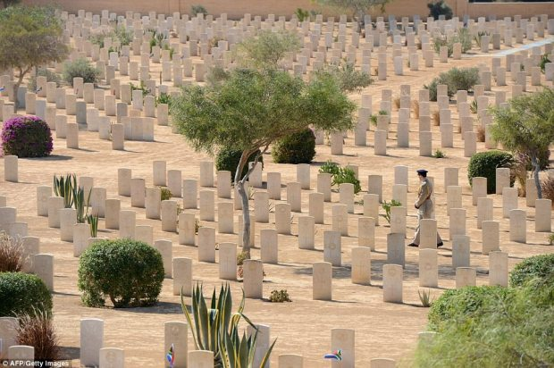 A soldier walks past the graves of fallen World War II soldiers, on October 20, 2012, during an international commemoration organized by Britain, to mark 70 years since the decisive battle that sealed the Allied victory in North Africa