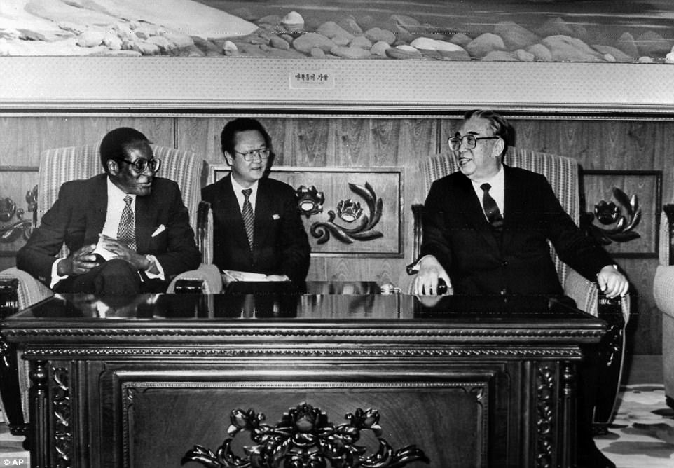 First heralded as a liberator who rid the former British colony Rhodesia of white minority rule, Robert Gabriel Mugabe was soon cast in the role of a despot who crushed political dissent and ruined the national economy. Pictured: Mugabe meeting with North Korea's Kim Il-Sung in 1993