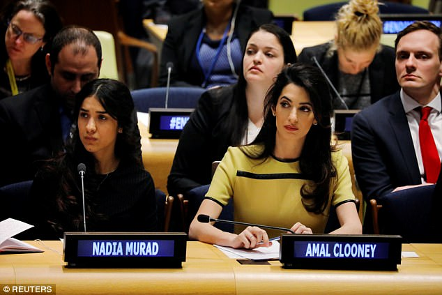 Murad finally escaped by jumping over the garden wall of her captor's house in Mosul. From therestrangers helped smuggle her to a refugee camp (Pictured, Murad, left, and international human rights lawyer Amal Clooney at UN headquarters, March 2017)