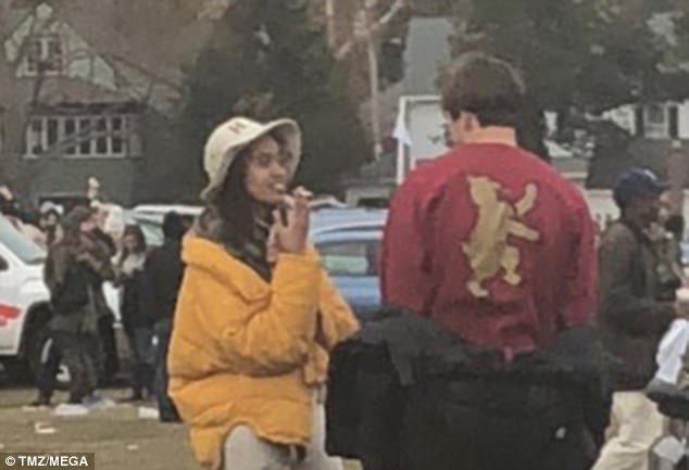 In another photo, Malia is smoking what appears to be a cigarette as she chatted withFarquharson