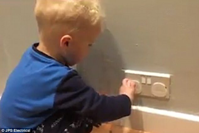 An electrician has told parents to remove plug socket covers  in order to protect their toddlers from being exposed to 230V currents.Mr Palmer posted a video on Facebook showing his sons removing covers (pictured)