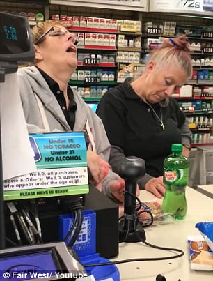 Midway through checking out the items, the cashiers are in a sleep-like state - one with her head down and the other with her head back and her mouth hanging open (left and right)