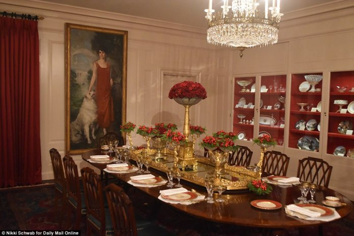 The White House's China Room was set up for Christmas dinner, featuring a table purchased by President James Monroe and Ronald Reagan's red and gold dishware