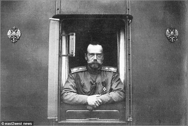 Russia's final emperor: Nicholas II pictured leaning from a train after his resignation