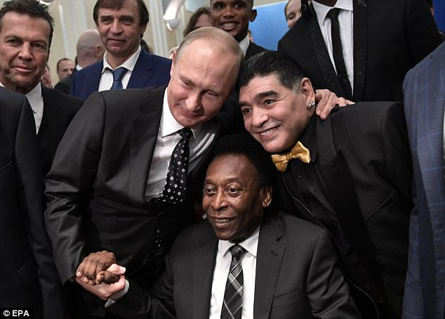 The two icons of the game posed for pictures with Russian president Vladimir Putin