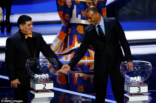 Maradona was greeted by former Brazil captain Cafu ahead of the draw taking place