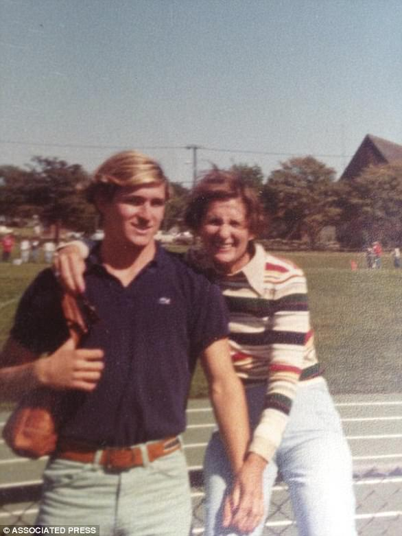 In this undated photo provided by Joe Flynn, Michael Flynn, left, stands with his mother Helen Flynn, right, near a football field, in Middletown, Rhode Island