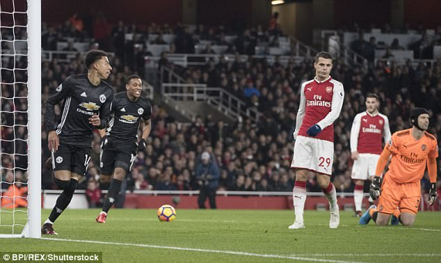 Jesse Lingard (left) wheels away after scoring his team's third goal against Arsenal