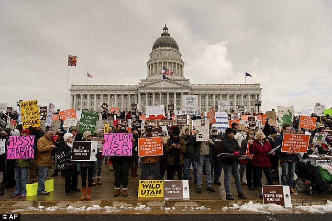 Protesters yelled 'Shame on You!' and 'F**k you Trump!' on Monday in front of the Utah state capitol; a different group of activists were dispersed by riot police outside the LDS Welfare Square facility