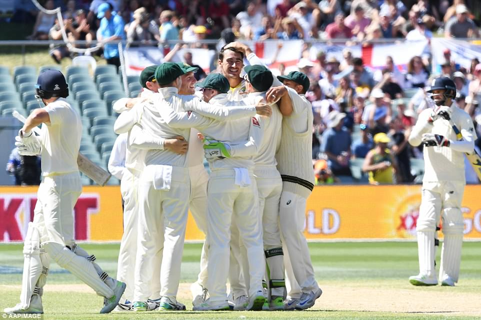 Starc is congratulated by his Australia team-mates after securing victory, while Bairstow walks off after being bowled