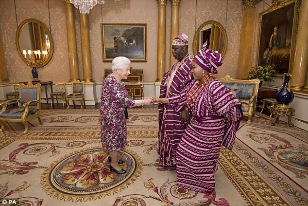The Queen accidentally coordinated perfectly with George Adesola Oguntade, the High Commissioner of the Federal Republic of Nigeria, and his wife Mrs Oguntade on Wednesday