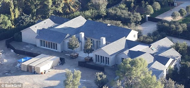 Under construction! Us Weekly has reported that Kim and her family are all moved into the home, which was once owned by Lisa Marie Presley and purchased by the reality star and her husband in 2014 for $20 million (pictured 2017)