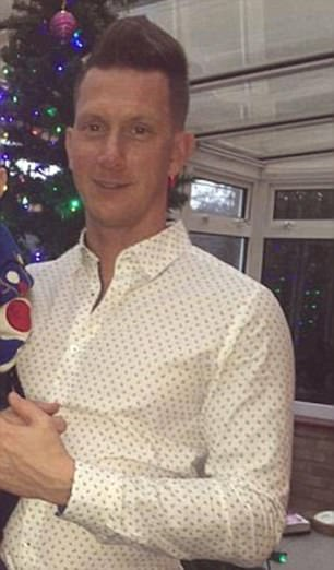 Mark Smith pictured with son Lucas by the Christmas tree