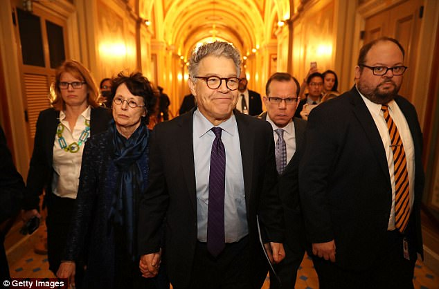DON'T FORGET TO SMILE: 'Even on the worst day of my political life, I feel like it's all been worth it,' said Franken, accompanied by his wife Franni Bryson as they arrive at the Capitol