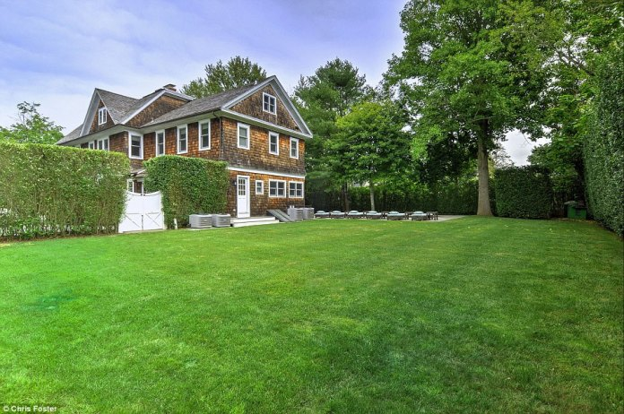 Plenty of room to play: The 4,239 square foot red-tile mansion sits on just over half an acre inBridgehampton
