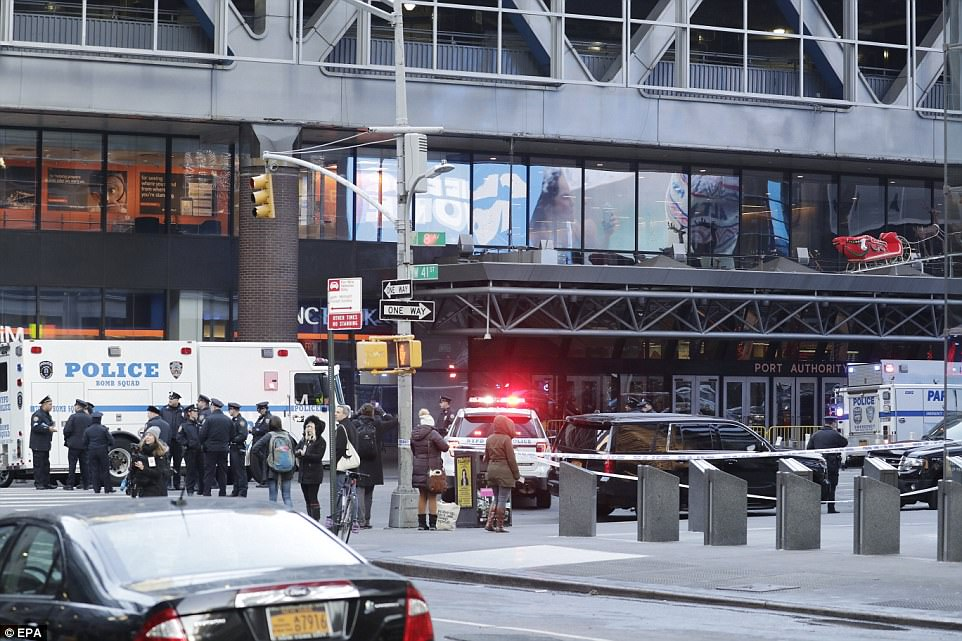 Port Authority remained entirely closed off on Monday morning at 9am. Above, the entrance at 8th Avenue and 41st Street