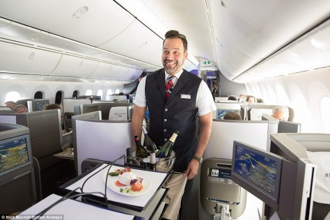 Class act: A British Airways air steward delivers the new, improved food service on a flight from London to New York