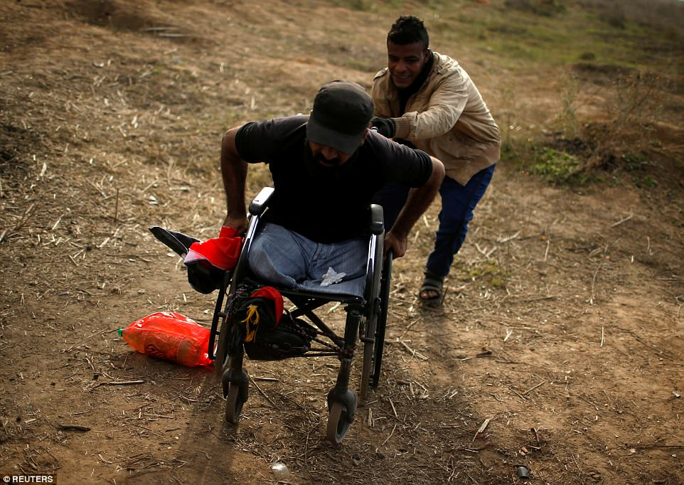 Wheelchair-bound Palestinian demonstrator Ibraheem Abu Thuraya, who according to medics was killed later on Friday during clashes with Israeli troops, is pushed during a protest against President Trump's Jerusalem declaration