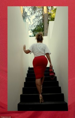 Bodacious: She showed off her curvaceous figure in a clinging red midi skirt