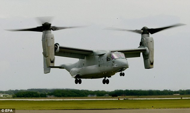 A V-22 Osprey, similar to the one pictured in this file image, was seen in aerial footage surrounded by what appeared to be a cordon and flashing lights on a police vehicle