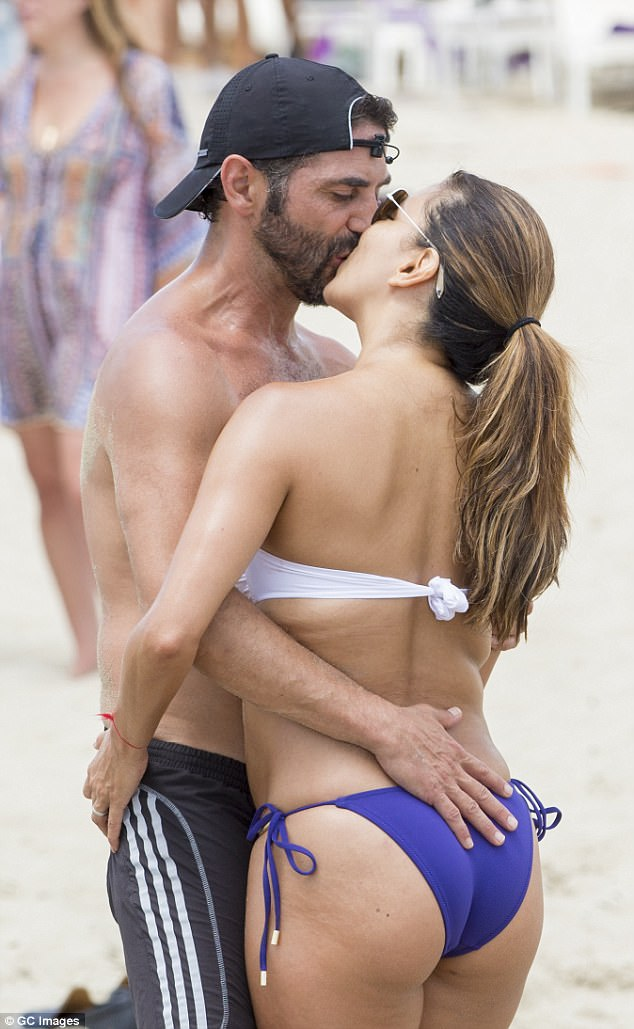 Passion: The lovebirds could barely keep their lips off one another as they smooched on the beach
