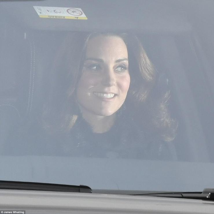 As always, Kate's hair was coiffed to perfection, and the Duchess appeared to be wearing a faux-fur trimmed coat