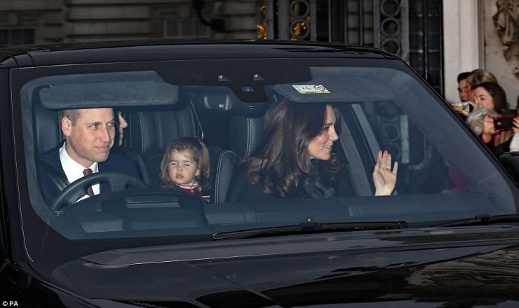 Following shortly behind were the Duke and Duchess of Cambridge with a sleepy looking Princess Charlotte in the back