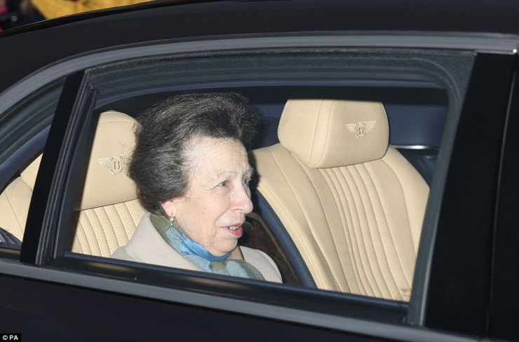 The Queen's daughter was wrapped up warm in a beige coat and a blue silk scarf as she made her way to the palace