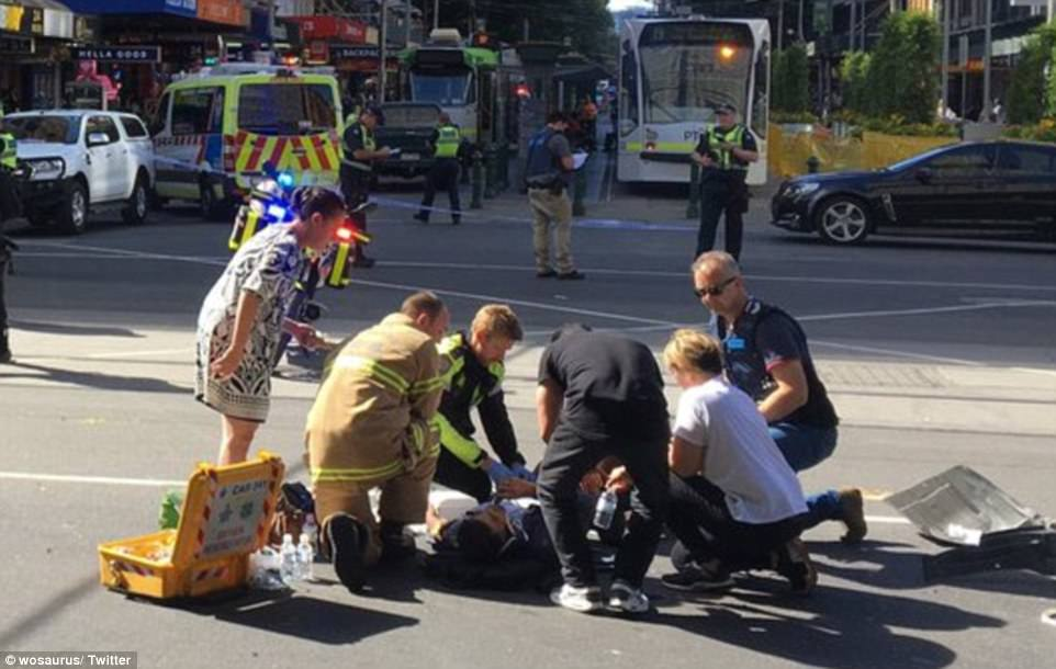 Chaotic scenes unfolded during peak-hour as the white SUV crashed into the group of panicked pedestrians (pictured)