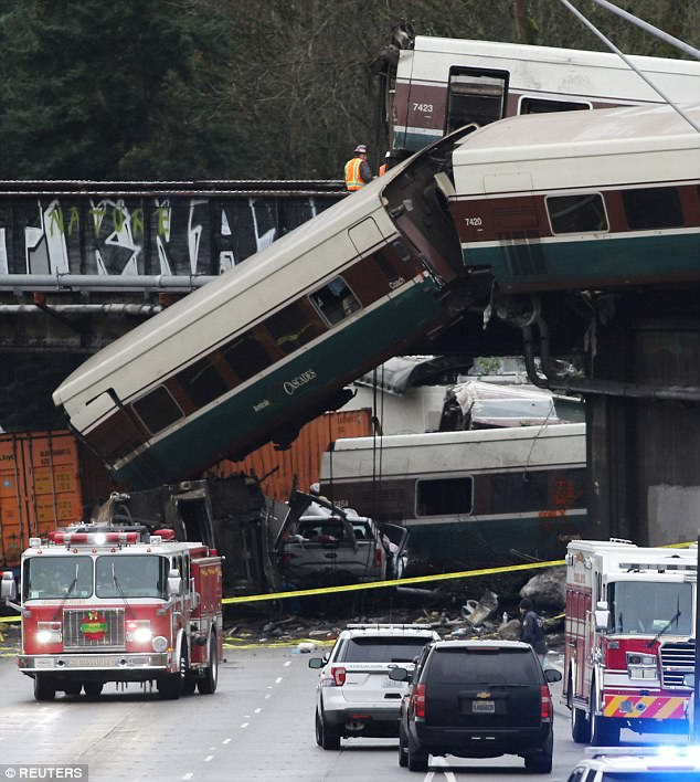 It's unclear why the train was traveling at 78mph in a 30mph zone. Additionally, technology called positive train control, or PTC, which can automatically slow down a speeding train, wasn't activated (Pictured, first responders are seen at the scene of the Amtrak crash)
