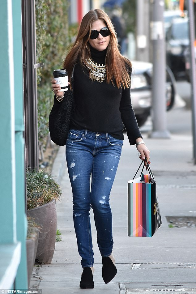 Shopping in style! Selma Blair cut an effortlessly sophisticated figure in a black turtleneck, ripped jeans, and a chunky gold necklace as she stepped out for some holiday shopping in Los Angeles