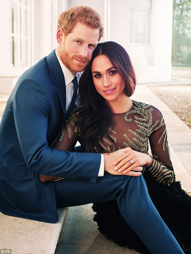 TRUE LOVE: Harry and the real Meghan – ring clearly on display – in last week's official engagement photo