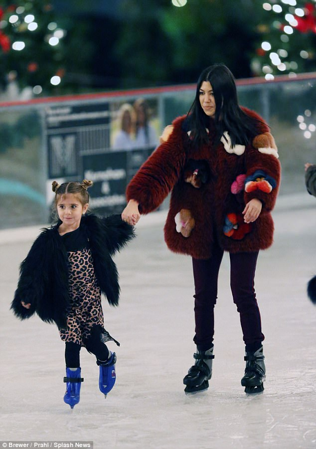 Mom! The eldest Kardashian daughter skated alongside her five-year-old daughter Penelope, he opted to match her mother's coat with a mini black version of her own