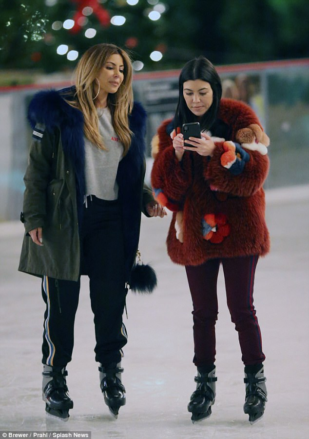 Toasty: Larsa Pippen, 43, covered up her famous figure with a forest green jacket complete with blue fur trim