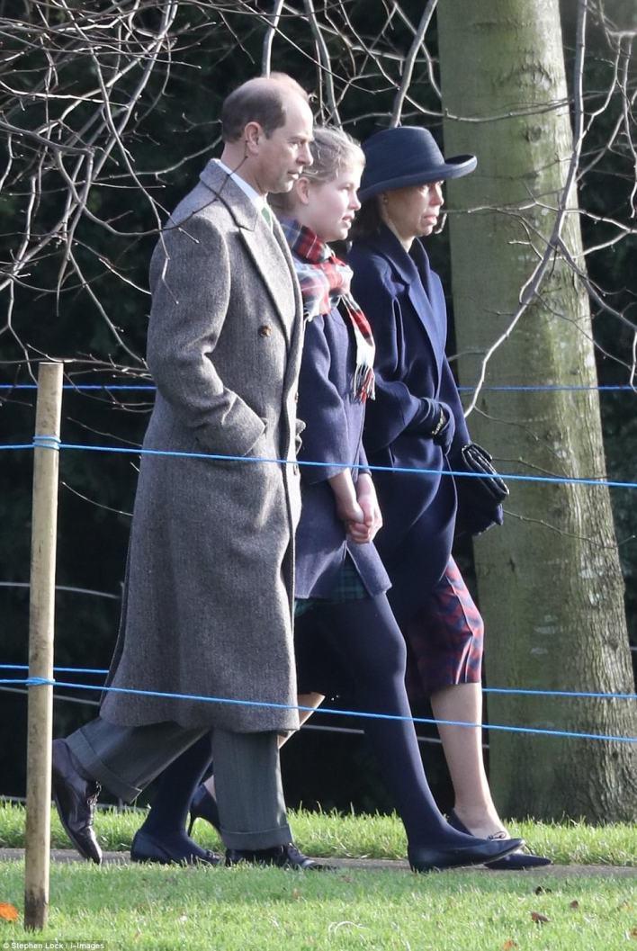 Prince Edward kept the chill away by putting his hands in his pockets, while his daughter Lady Louise Windsor gripped her hands together as she strode along pruposefully