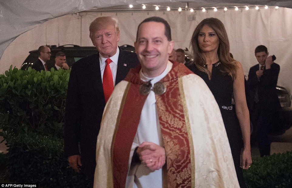 The Trumps were escorted from their motorcade vehicle by the Rev. James R. Harlan as they arrived for Christmas Eve service at the Church of Bethesda-by-the-Sea in West Palm Beach, Florida late Sunday