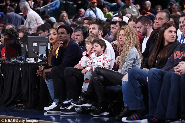 Famous families: Chris Rock and his family sat next to Shakira and Gerard and their boys