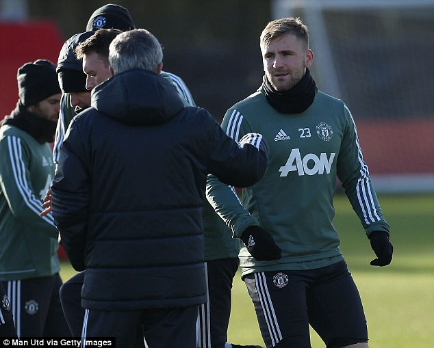 Mourinho hands out instructions to Luke Shaw as he prepares for the game on Saturday