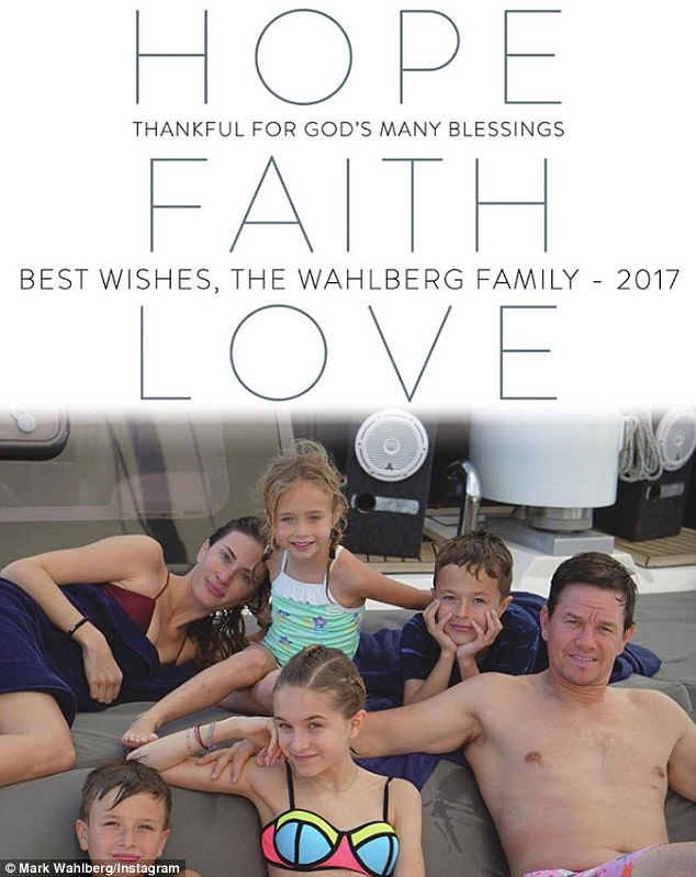 Their Christmas card: The clan seen on what appears to be a private yacht